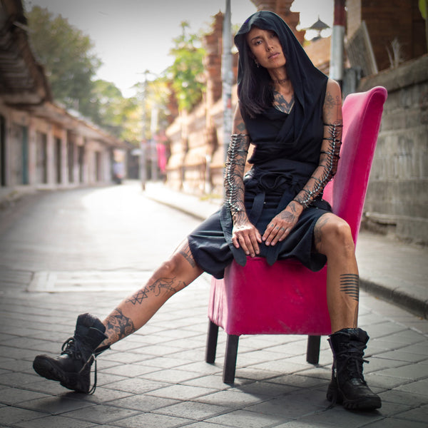 Fa wearing psylo fashion unisex clothing sitting on armchair in middle of empty street