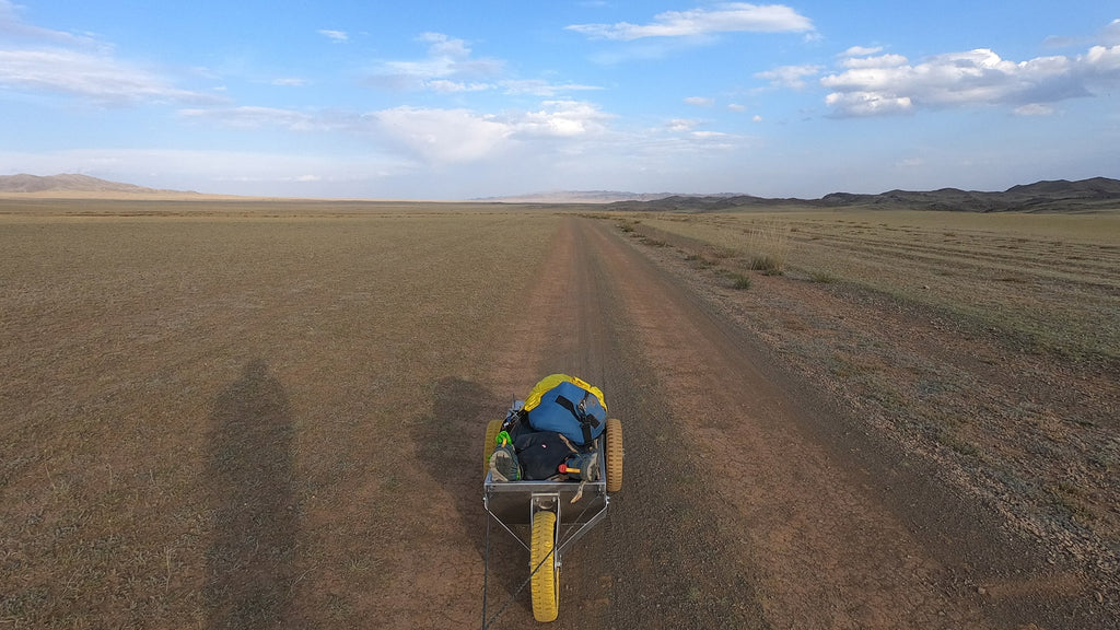View of the Gobi desert and Max's cart for carrying all his equipment for the expedition