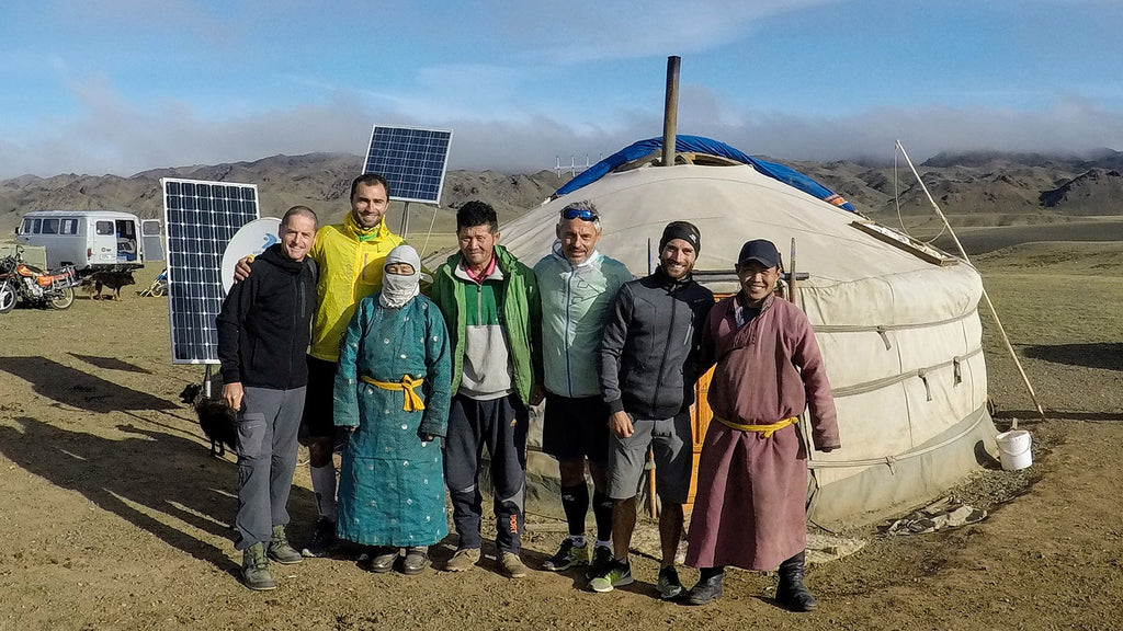 Max standing with local friends in front of yurt at the Gobi desert, Mongolia