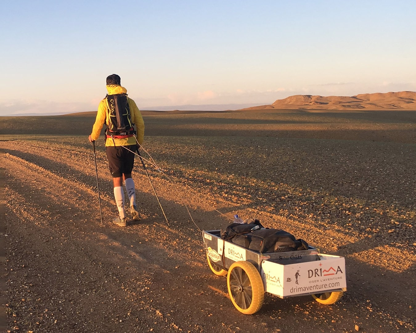 Max crossing walking the Gobi desert in Mongolia