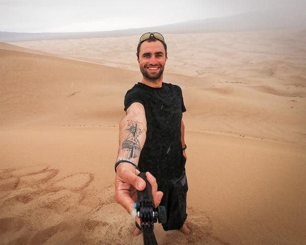 Max wearing Psylo clothing during his journey in the gobi desert, Mongolia