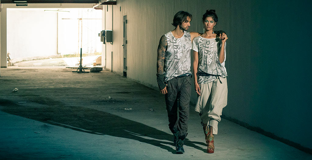 Man and woman wearing Psylo fashion ethical streetwear graphic tee and baggy pants
