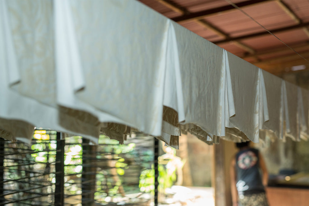 Psylo Fashion's natural fabrics drying after Screen-printing at our silk screen workshop