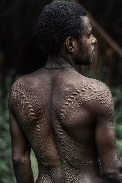 Man showing his Crocodile scars in Papua New Guinea by Trevor Cole