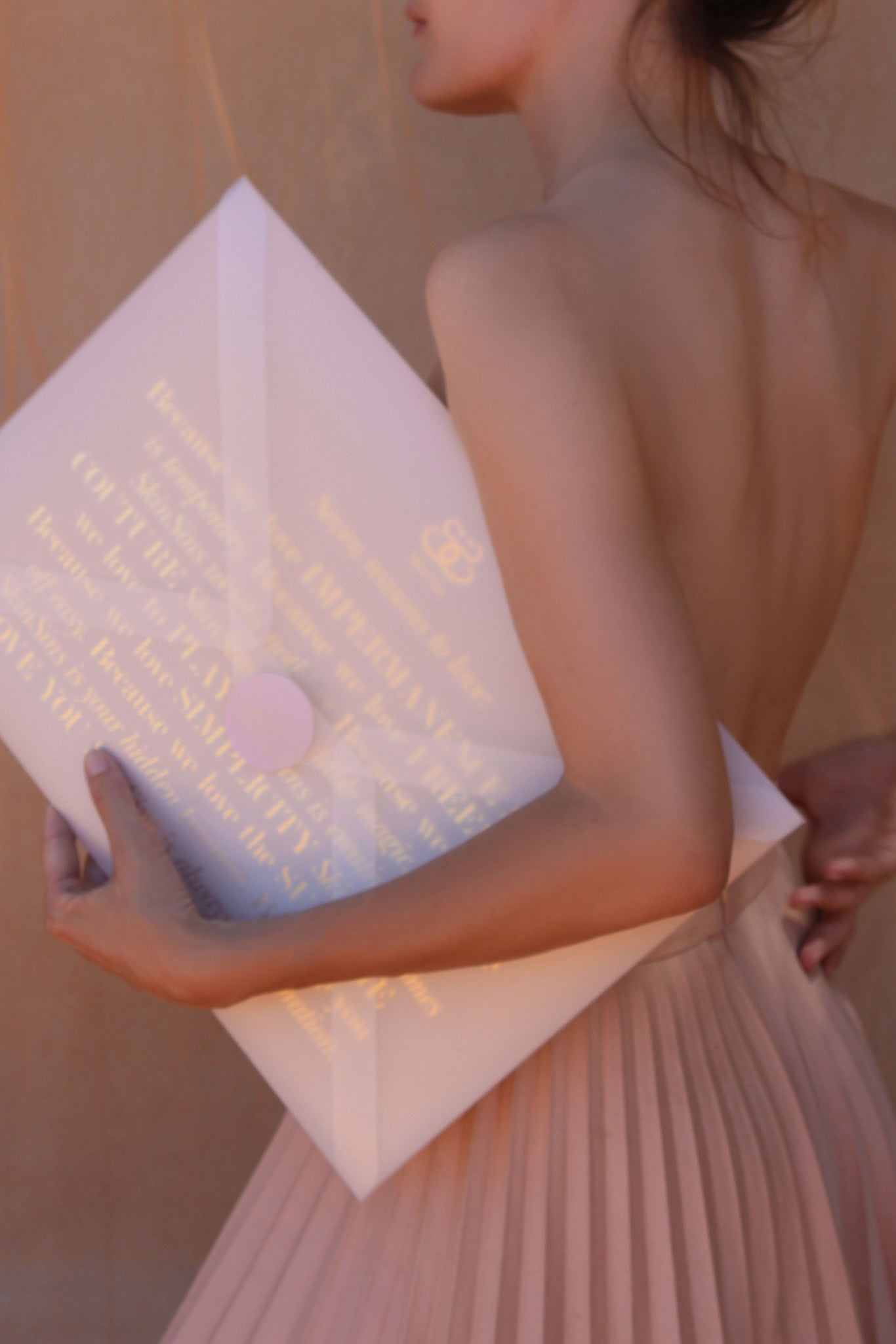 SkinSins packaging, oversized clutch envelope in nude pink