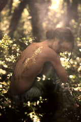 Temporary Gold Tattoo Flowers in forest on Audrey Marnay by Kate Bellm