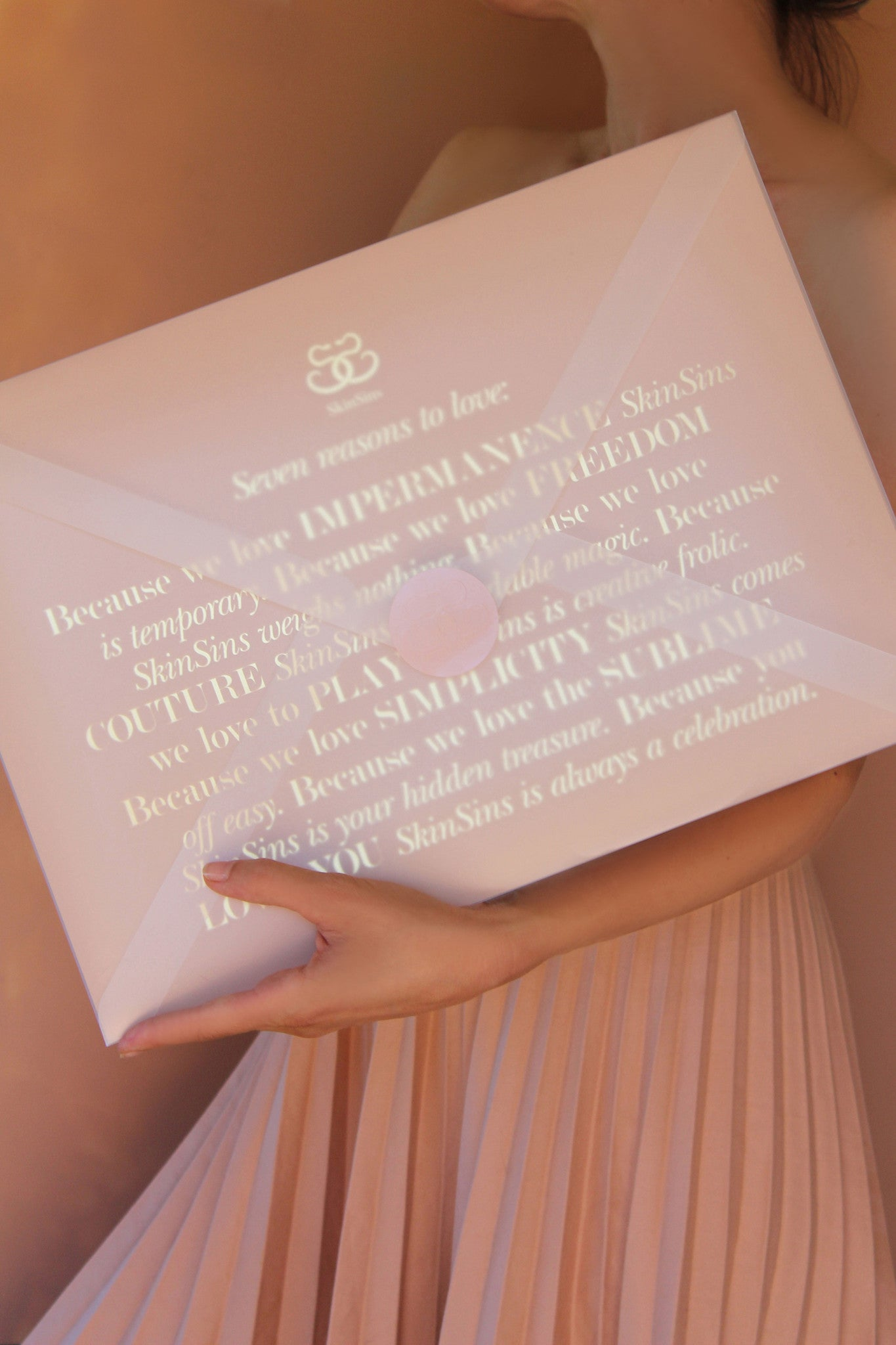 Oversized envelope packaging design by SkinSins in nude pink