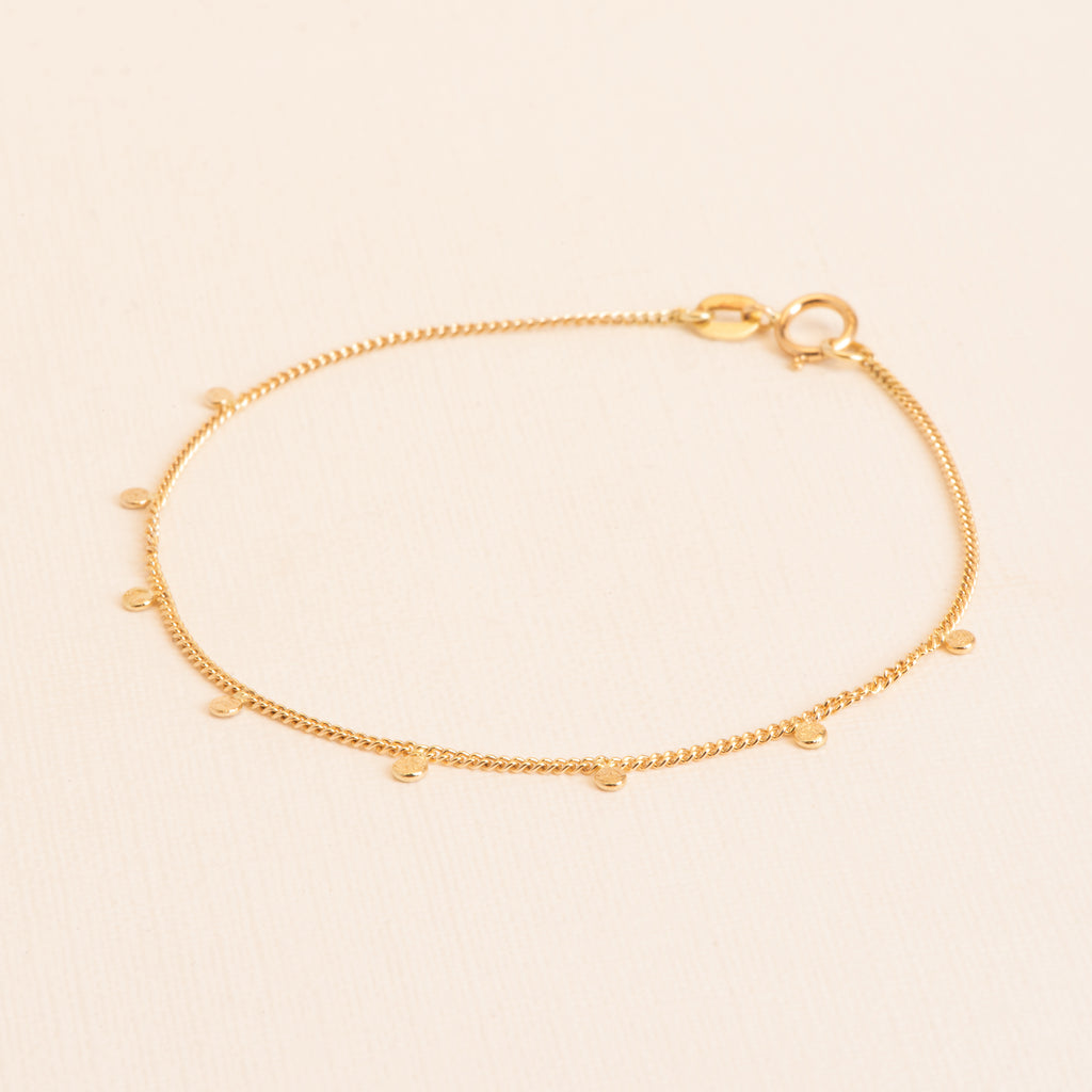 18kt Gold fine Bracelet with Charms