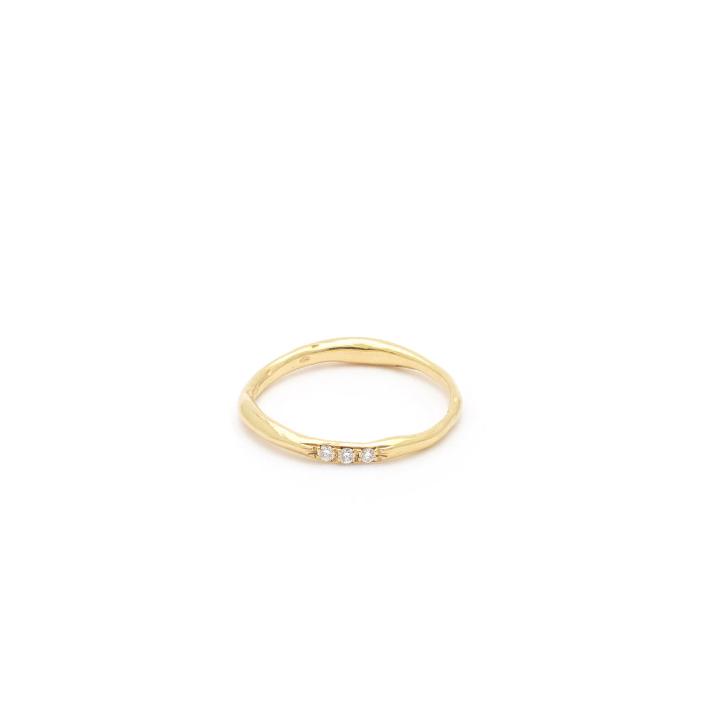18kt Gold ring with organic band and three White Diamonds