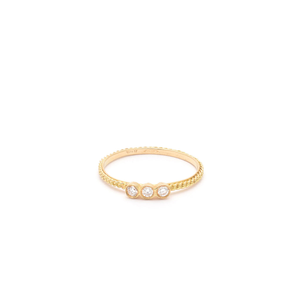 18kt Gold Ring with three White Diamonds