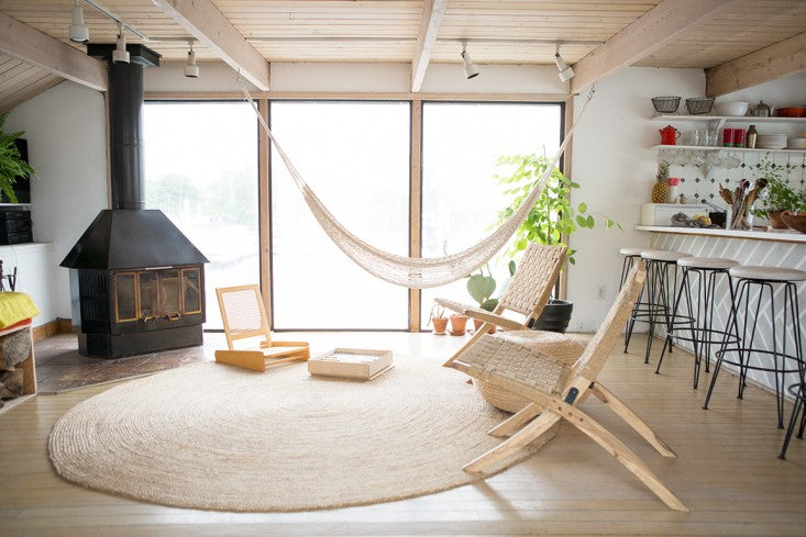 indoor hammock chair by fireplace