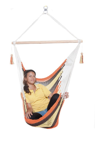 woman in a hanging hammock chair