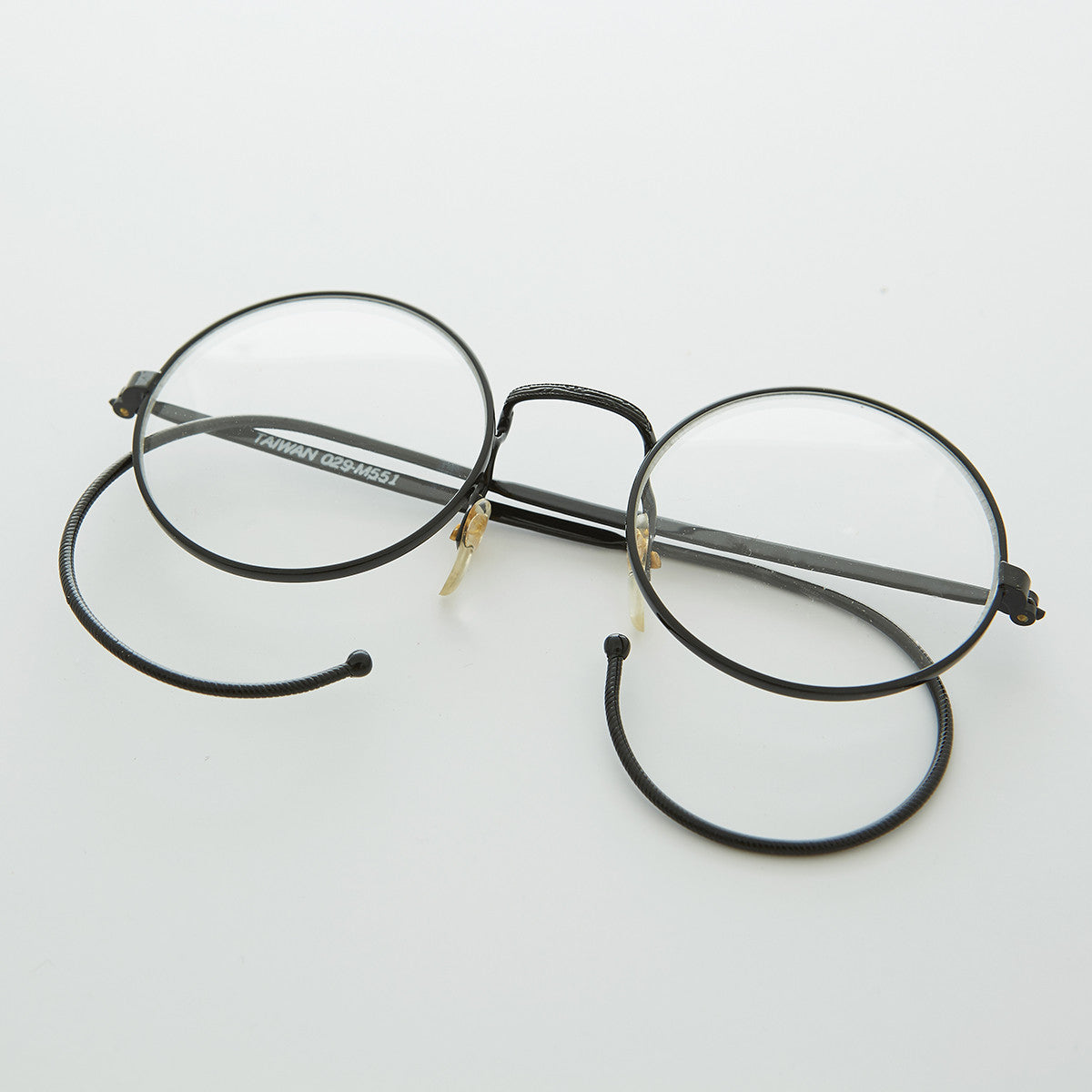 round clear lens vintage glasses with cable temples