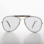 vintage aviator sunglass with brow bar and  transition lens