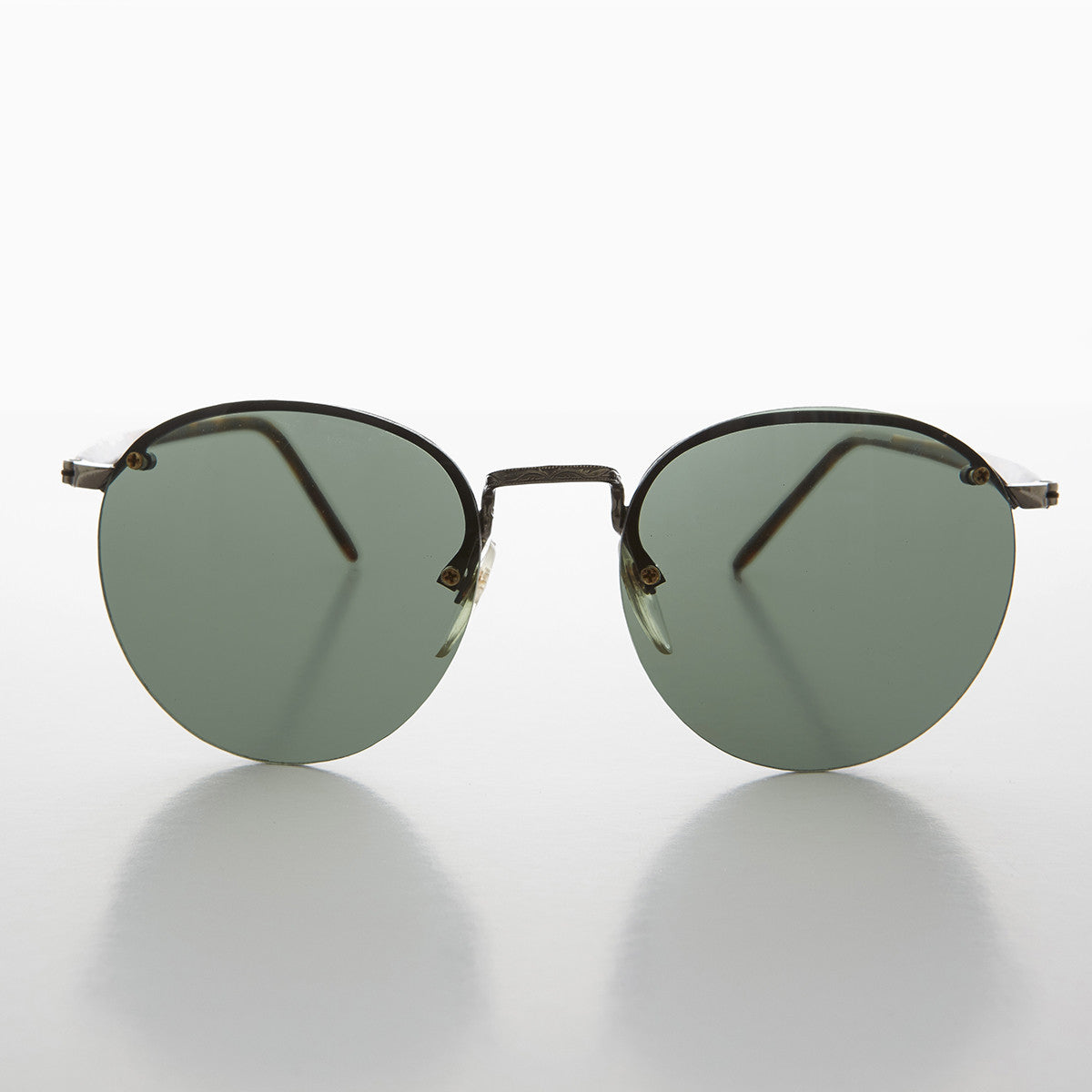 round rimless sunglass with green lens