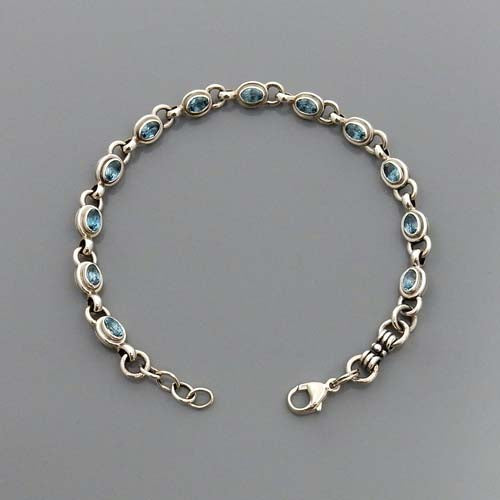 Adjustable Blue Topaz Sterling Silver Link Bracelet
