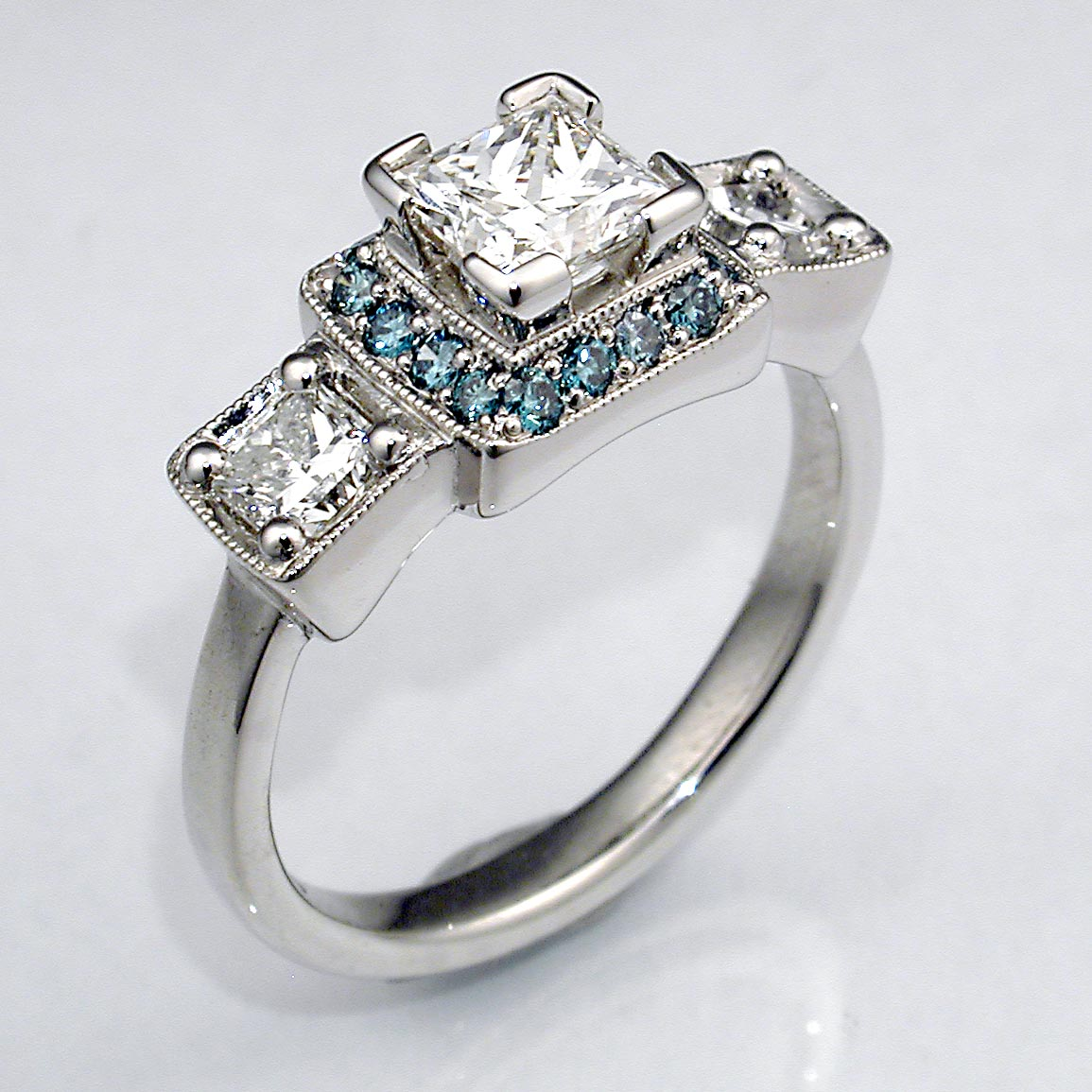 Three Stone Diamond Engagement Ring w/Blue Diamond Halo