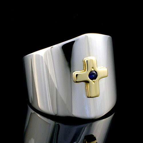 Stylish two toned silver and gold sapphire cross ring