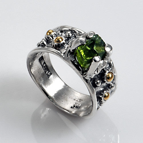 Nice two toned silver and gold peridot ring