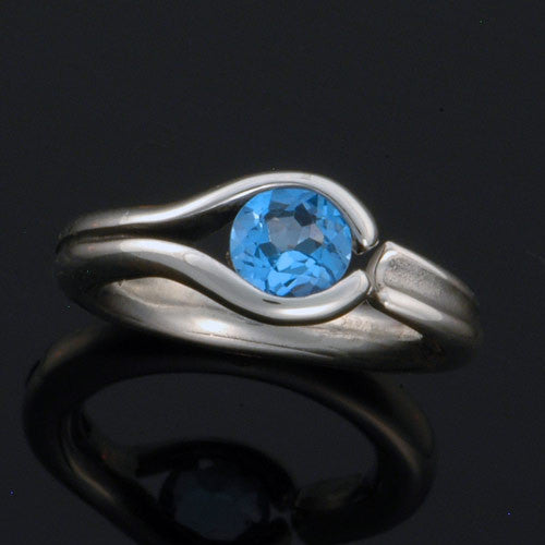 Unique blue topaz sterling silver tension set ring