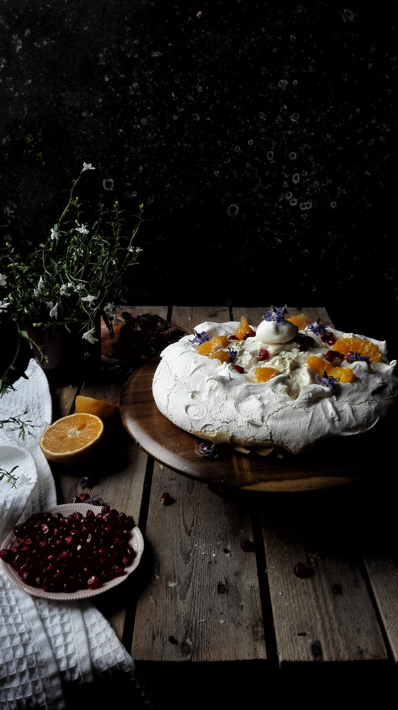 Vegan Pavlova with Orange Blossom Cream Cheese and Pomegranate Molasses from Nine Tea Cups Bakery