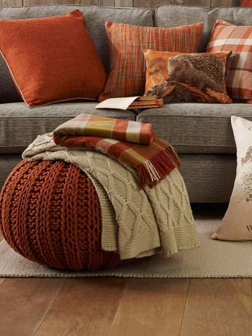 fall decor orange pillows plaid blankets
