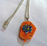 Tree of Life Necklace on Orange Agate Irregularly shaped stone with Swarovski Flat Back Crystals adorning the Tree of Life
