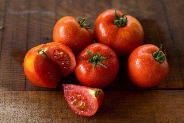 tomatoes on a wooden counter top