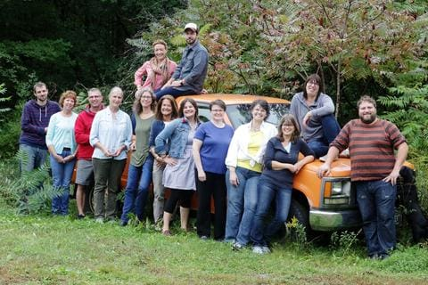 Pinetree staff photo with old orange pickup truck