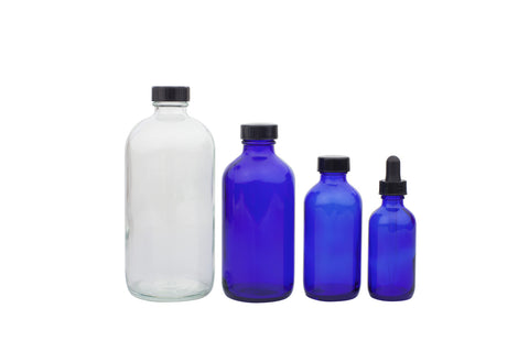 row of 4 empty product bottles
