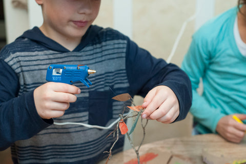 Older kids can use the glue gun, while adults can help smaller kids get the leaves on right
