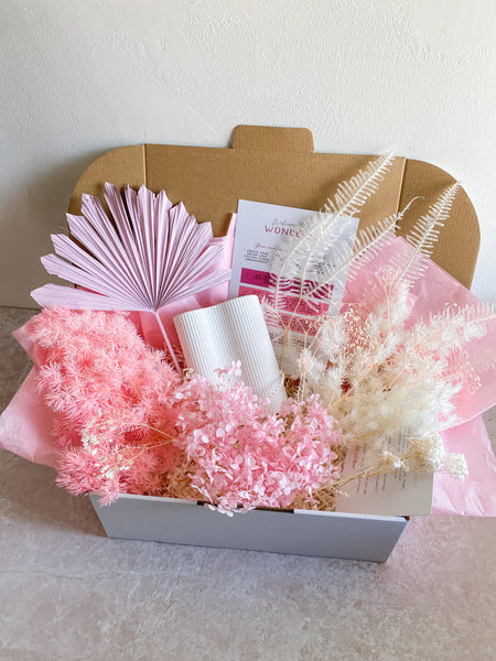 A DIY kit consisting of a box containing dried flowers, a vase and instructions.