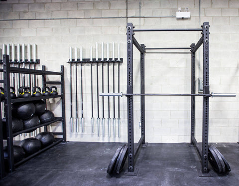 Fitness center racks, barbells and weights