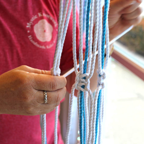 Tying plant hangers at Mystic Knotwork