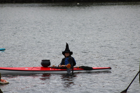 a kayaking witch on the Mystic River
