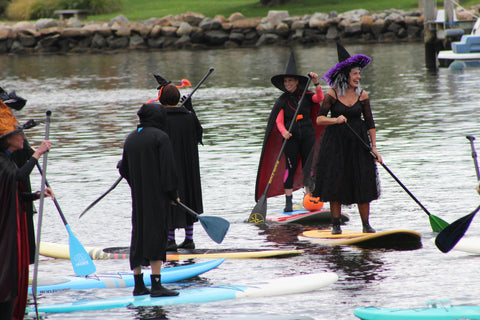 a gathering of paddling witches on the Mystic River
