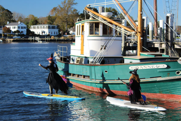 Witch paddle participants head out on the Mystic River