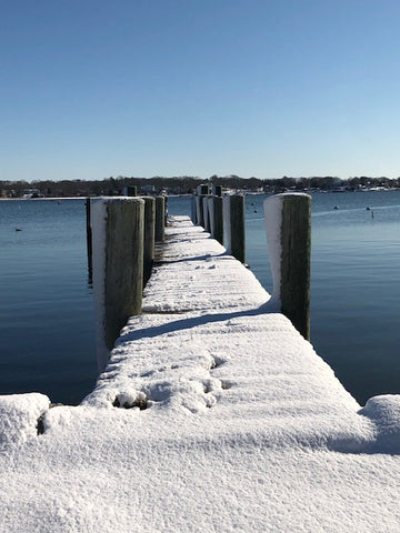 a snowy dock on the Mystic River