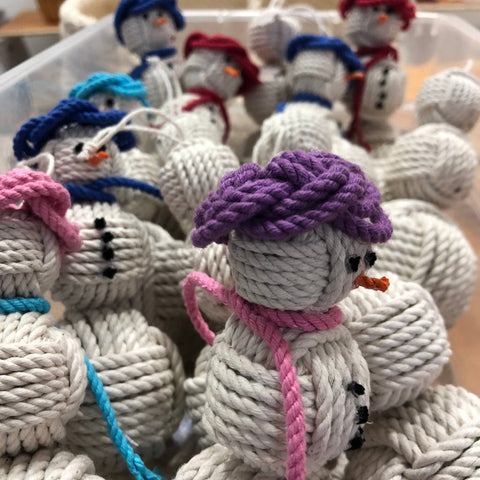 a pile of snowman ornaments