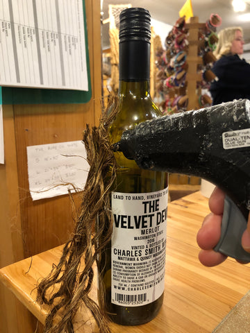 glue rope onto wine bottle for Christmas Gnome