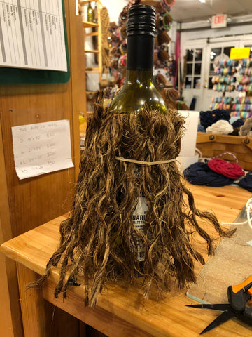 keep adding rope to wine bottle of Christmas Gnome