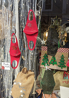 holiday masks in downtown Mystic