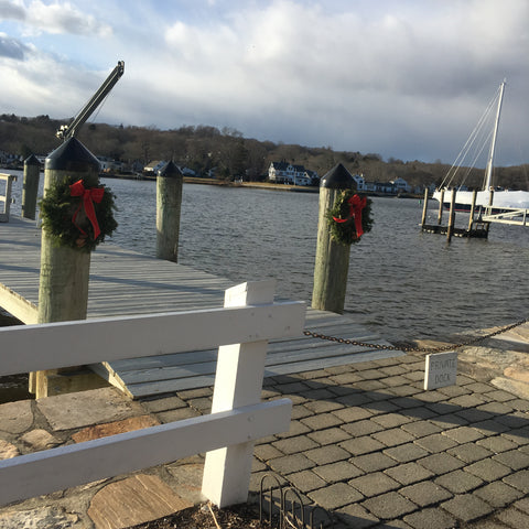 Mystic river dock with wreaths at Christmas time