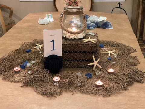 beach wedding centerpiece with starfish and monkey fist