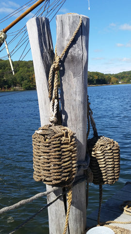 Rope fenders on boat pilings in Mystic Connecticut