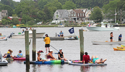 paddlers gather to listen at Mystic's Floatchella 2021