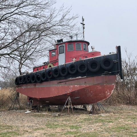 red tug boat on the hard in Mystic