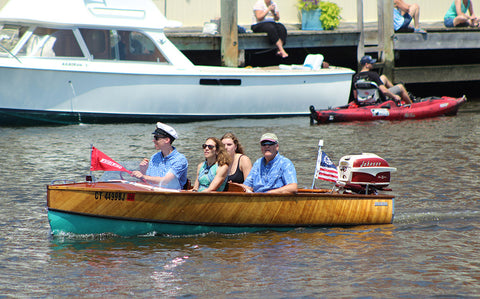antique runabout with a running antique engine