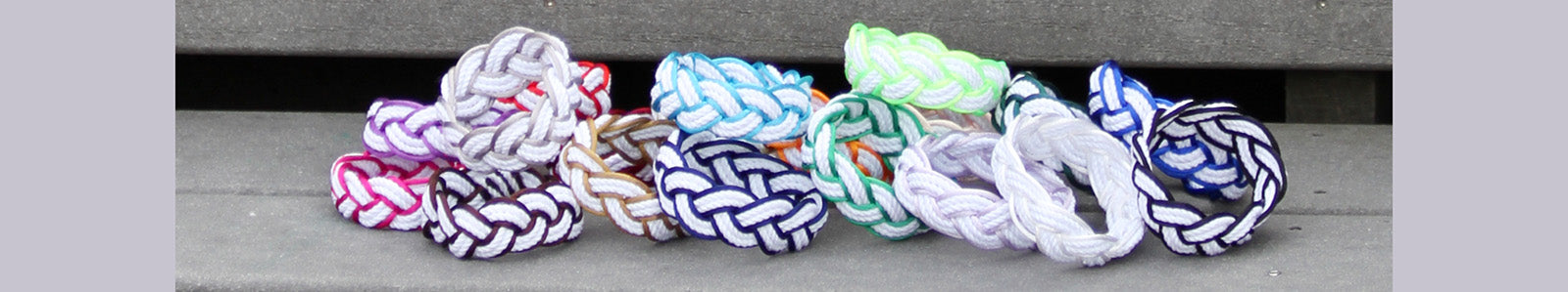 Photo of our collection of Satin outlined nautical sailor bracelets