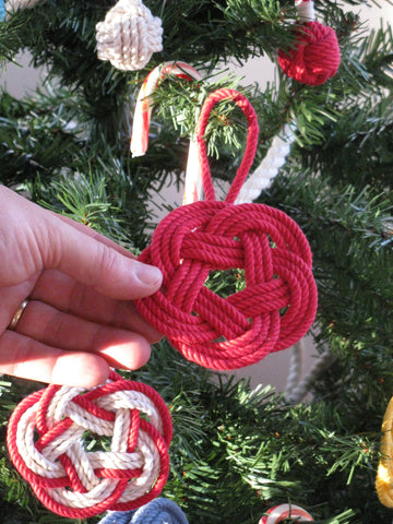 red coaster ornament on the holiday tree